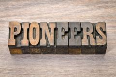 Pioneers banner in letterpress woodtype. Pioneers banner - text in vintage letterpress wood type - French Clarendon font popular in western movies and stock photography