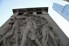 The Pioneers Bas Relief Sculpture in Chicago. The Pioneers limestone relief portrays fur trader John Kinzie leading a group of non-native settlers into Indian Royalty Free Stock Photography