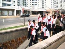 Pioneers Pyongyang, in North Korea. Pyongyang, in North Korea. Pioneers schoolboys go all together. North Korea is a communism country Royalty Free Stock Photos