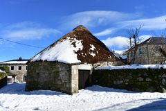 Free Piornedo, Ancares, Lugo Province, Galicia, Spain. Ancient Snowy Palloza House Made With Stone And Straw. Mountain Village. Royalty Free Stock Photos - 138823098