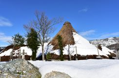 Piornedo, Ancares, Galicia, Spain. Ancient snowy palloza houses made with stone and straw. Mountain village, winter and snow. royalty free stock photos