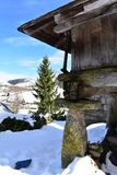 Snowy mountain village with galician granary horreo and fir tree. Piornedo, Lugo, Spain. royalty free stock photography