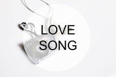 Piosenki miłosnej tła om audio kasety taśmy kształta serce Zdjęcia Royalty Free