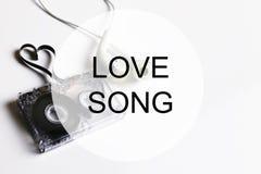 Piosenki miłosnej tła om audio kasety taśmy kształta serce Obrazy Royalty Free