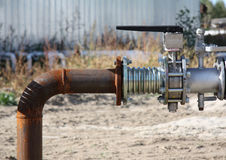 Pipe. Gasoline pipe with Crane on blur background Royalty Free Stock Photo
