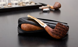 Pipe. Two briar pipe on sofa with accessories and case Stock Photos