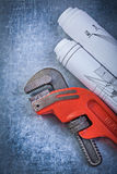 Pipe adjustable wrench construction plans on metallic background Stock Image