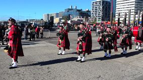 Pipe band celebrate the Queen's Birthday stock video footage