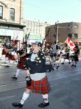 Pipe Band and Highland Dancers Stock Photos