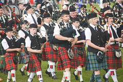 Pipe bands at Nairn. Royalty Free Stock Photography