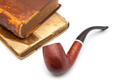 Pipe and book Stock Image