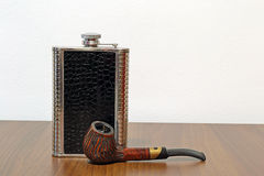Pipe And Canteen. On A Wooden Table Royalty Free Stock Images