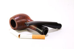 Pipe and cigarette Stock Images