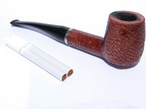 Pipe and cigarettes Royalty Free Stock Photo