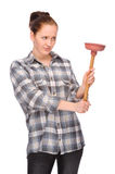 Pipe clogging. Full isolated studio picture from a young woman with plunger Royalty Free Stock Image