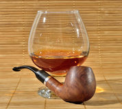 Pipe and cognac Royalty Free Stock Image