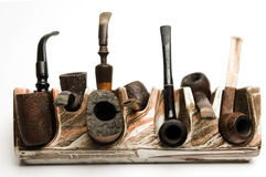 Pipe collection on modern pipe rack Royalty Free Stock Photo