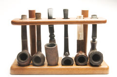Pipe collection in wood pipe rack Royalty Free Stock Photography