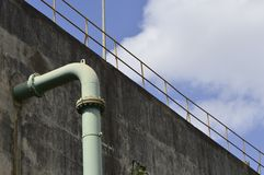 Pipe coming out of a concrete wall. Stock Images