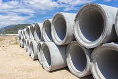 Precast concrete manholes are stored on the ground ready for con Royalty Free Stock Images