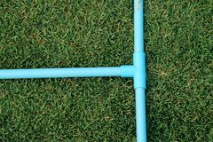 Pipe connection, T socket PVC tube ,tree way blue pvc pipe in green garden stock photography