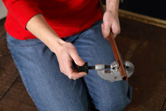 Pipe cutting. Woman using a pipe cutter Royalty Free Stock Photos