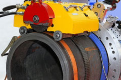 Pipe cutting machine. Big pipe saw cutting and beveling machine Royalty Free Stock Photography