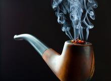 Pipe de fumage Photographie stock libre de droits