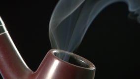 Pipe de tabac banque de vidéos
