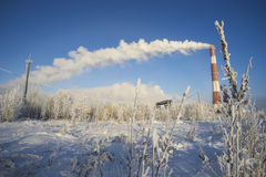 The pipe emerging from clouds of steam in winter . Stock Photo