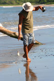 Pipe fisherman. Fisherman in Costa Rica fishing with a piece of pipe and fishing line Royalty Free Stock Photos