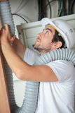 Pipe fitter installing pipe. Pipe fitter installing a pipe Royalty Free Stock Photography