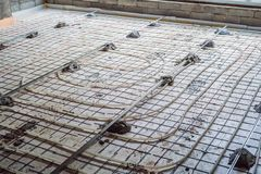Pipe fitter mounted underfloor heating. Heating system and underfloor heating royalty free stock photography