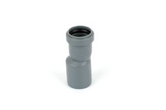 Pipe fitting - pvc reducer. Photo of plumbing pvc reducer for drainage used in water distribution systems, bathroom renovation concept Royalty Free Stock Photography
