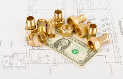 Pipe fittings with dollars on draft Royalty Free Stock Photo