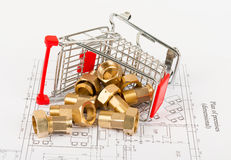 Pipe fittings with shopping cart Stock Images