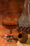 Pipe, Glass and bottle of brandy Royalty Free Stock Photo