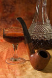 Pipe, Glass and bottle of brandy Royalty Free Stock Image