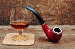 Pipe and glass of cognac Royalty Free Stock Photography