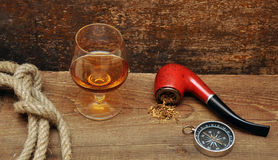 Pipe and glass of cognac Stock Images