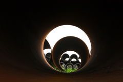 Pipe on grass. View from a pipe Royalty Free Stock Photo