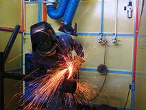 Pipe grinding. Worker grinding pipe before weld Royalty Free Stock Images