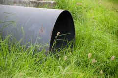 Pipe on the ground. In garden royalty free stock photo