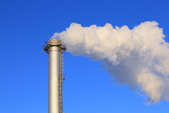 Pipe industrial boiler close up and white smoke Royalty Free Stock Photography
