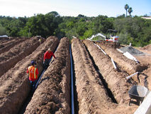 Pipe Installation for Irrigation. Installation of pipes in backyard for Irrigation Stock Photo