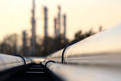 Pipe line conection in oil refinery. During sunset Stock Images