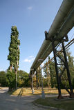Pipe line between two factories. Big pipe line between two factories Royalty Free Stock Photography