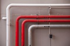 Pipe line on the wall. Of the building Stock Photo