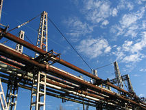 Pipe lines. Construction of old pipe lines, blue sky with a few clouds Royalty Free Stock Image