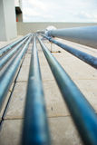 Pipe lines with tiles Royalty Free Stock Images